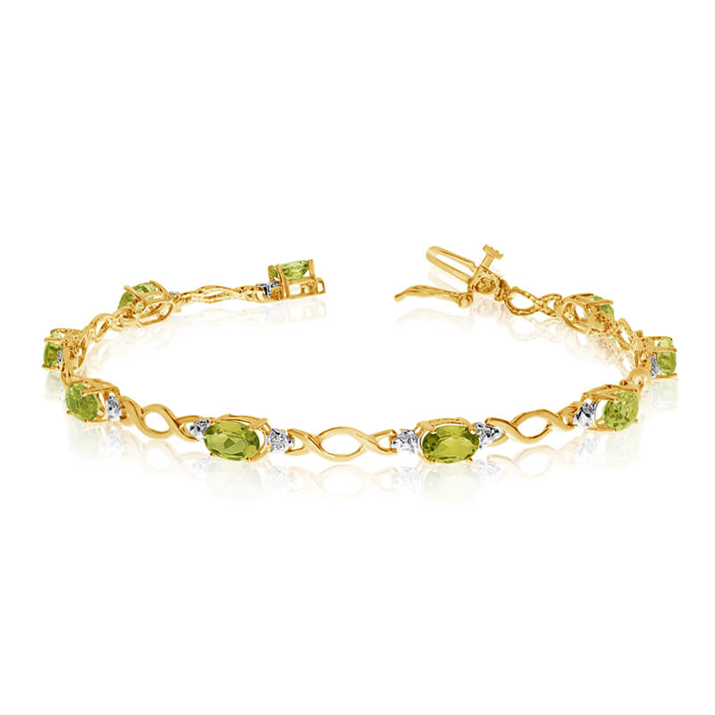 This 14k yellow gold oval peridot and diamond bracelet features ten 6x4 mm stunning natural perid...