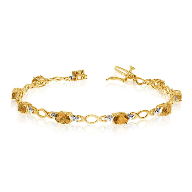 This 14k yellow gold oval citrine and diamond bracelet features ten 6x4 mm stunning natural citri...