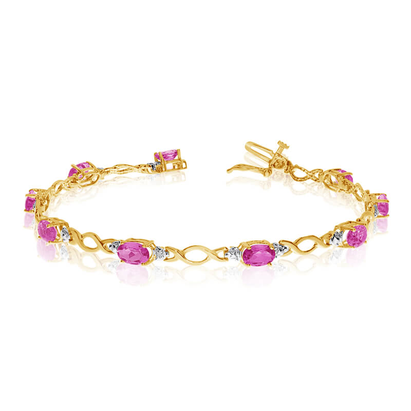 This 14k yellow gold oval pink topaz and diamond bracelet features ten 6x4 mm stunning natural pi...