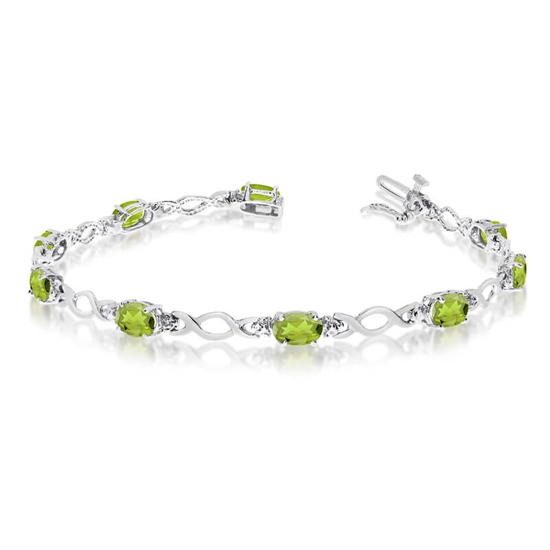 This 14k white gold oval peridot and diamond bracelet features ten 6x4 mm stunning natural perido...