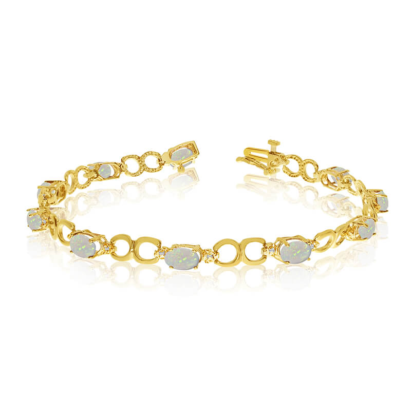 This 10k yellow gold oval opal and diamond bracelet features ten 6x4 mm stunning natural opal sto...