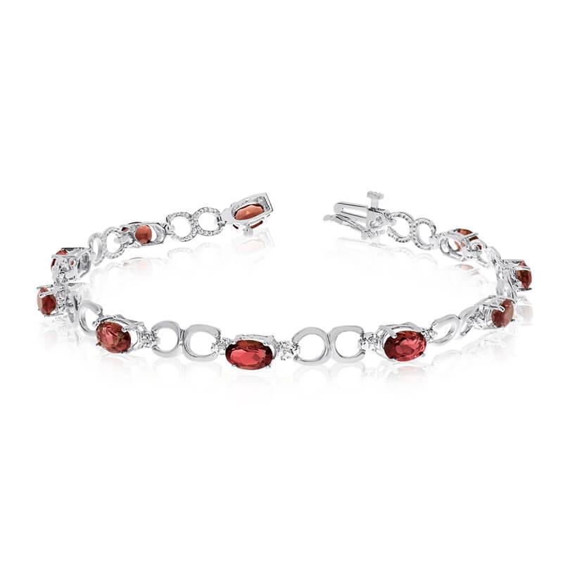 This 10k white gold oval garnet and diamond bracelet features ten 6x4 mm stunning natural garnet ...