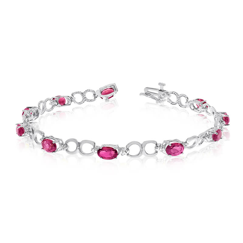 This 10k white gold oval ruby and diamond bracelet features ten 6x4 mm stunning natural ruby stones with 3.60 ct total gem weight.