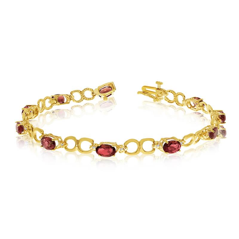This 14k yellow gold oval garnet and diamond bracelet features ten 6x4 mm stunning natural garnet...