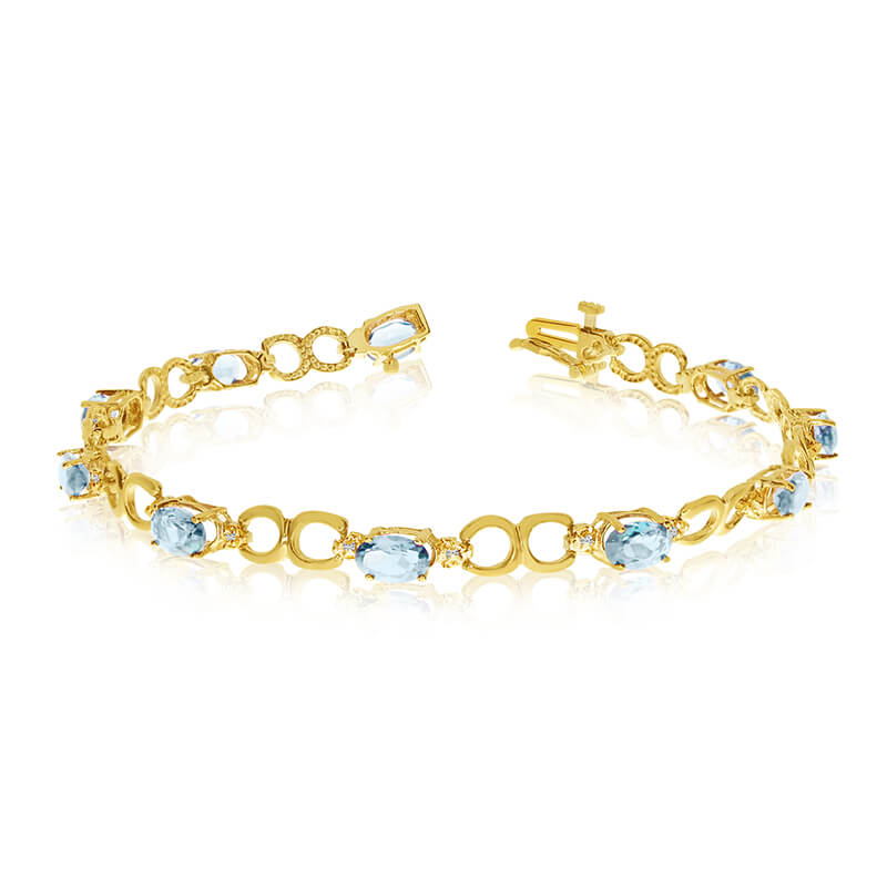 JCX3224: This 14k yellow gold oval aquamarine and diamond bracelet features ten 6x4 mm stunning natural aquamarine stones with 2.90 ct total gem weight.