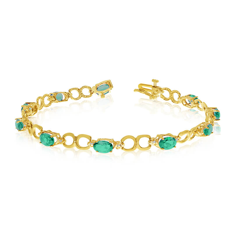 This 14k yellow gold oval emerald and diamond bracelet features ten 6x4 mm stunning natural emera...