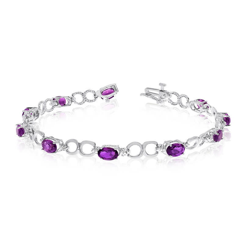 This 14k white gold oval amethyst and diamond bracelet features ten 6x4 mm stunning natural ameth...