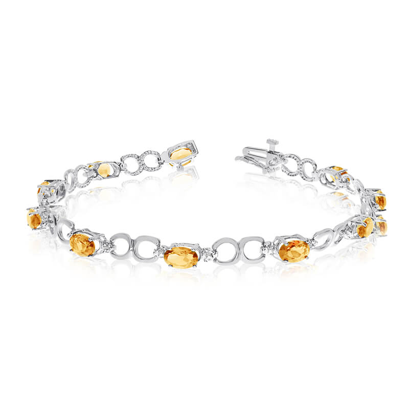 This 14k white gold oval citrine and diamond bracelet features ten 6x4 mm stunning natural citrine stones with a 3.10 ct total gem weight.