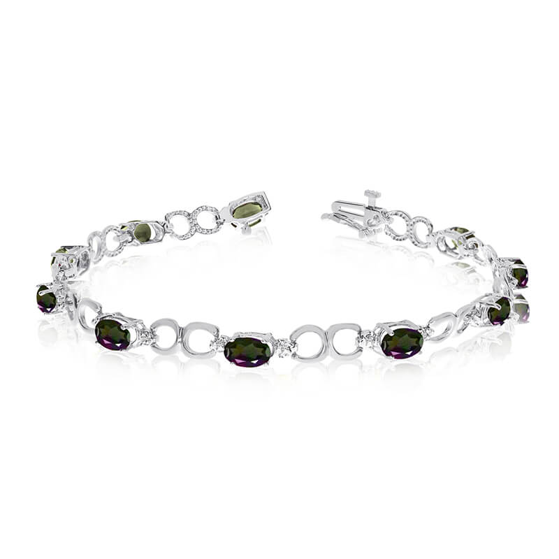 This 14k white gold oval mystic topaz and diamond bracelet features ten 6x4 mm stunning natural m...