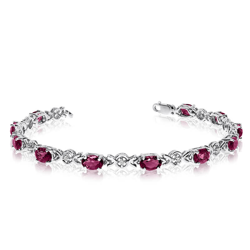 This 10k white gold oval ruby and diamond bracelet features eleven 6x4 mm stunning natural ruby s...