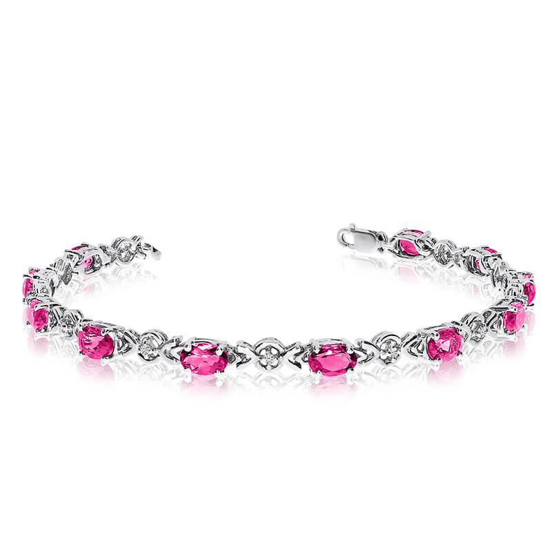 This 10k white gold oval pink topaz and diamond bracelet features eleven 6x4 mm stunning natural ...