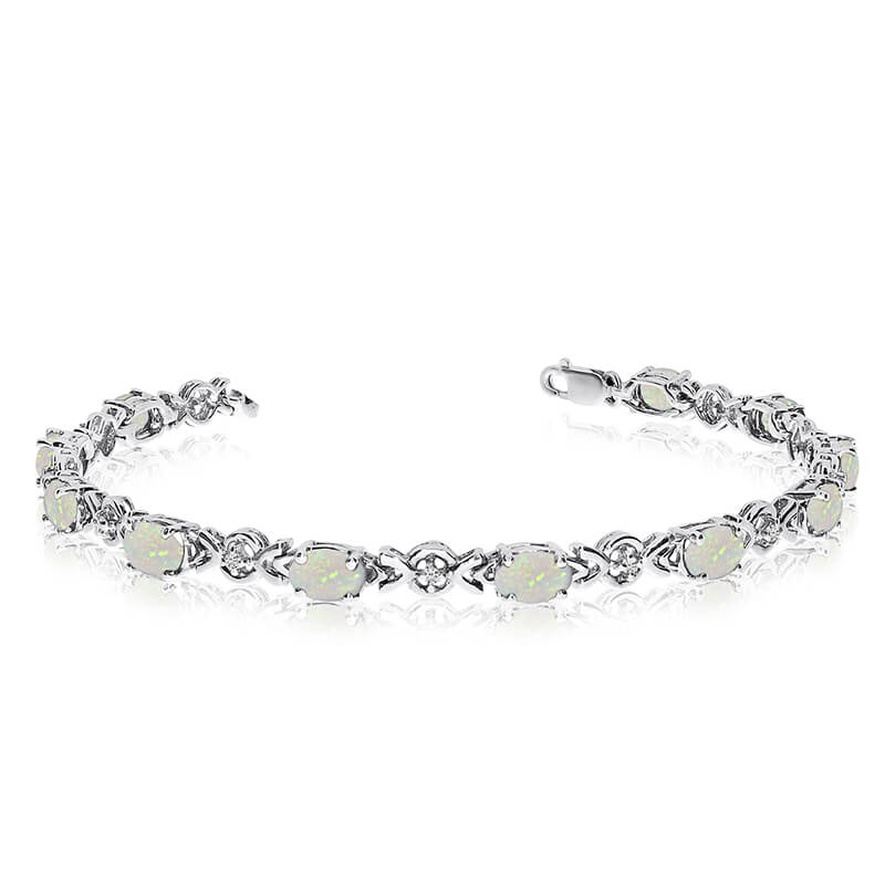 This 14k white gold oval opal and diamond bracelet features eleven 6x4 mm stunning natural opal s...