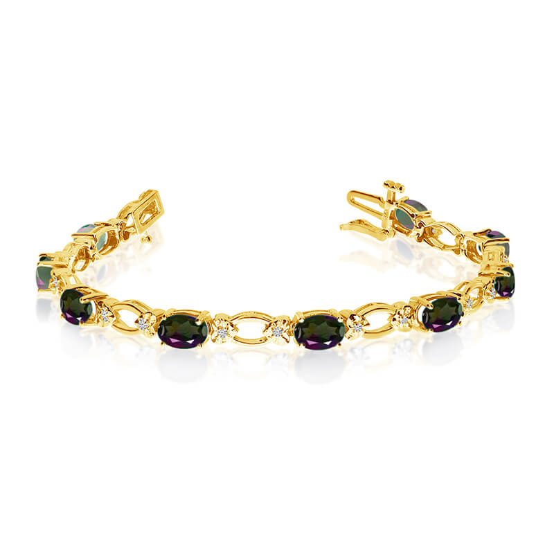 This 14k yellow gold natural mystic topaz and diamond tennis bracelet features 12 oval all natura...