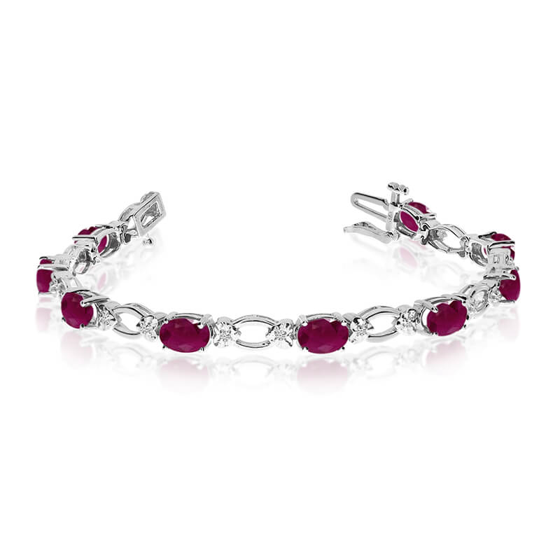 This 14k white gold natural ruby and diamond tennis bracelet features 12 oval rubys with a total ...