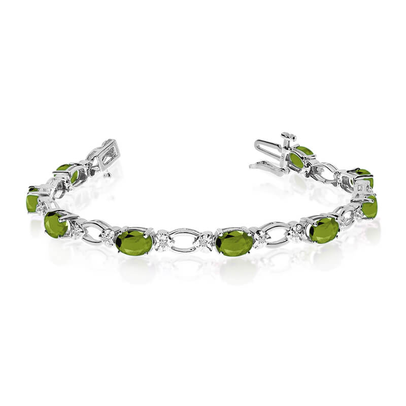 This 14k white gold natural peridot and diamond tennis bracelet features 12 oval peridots with a ...