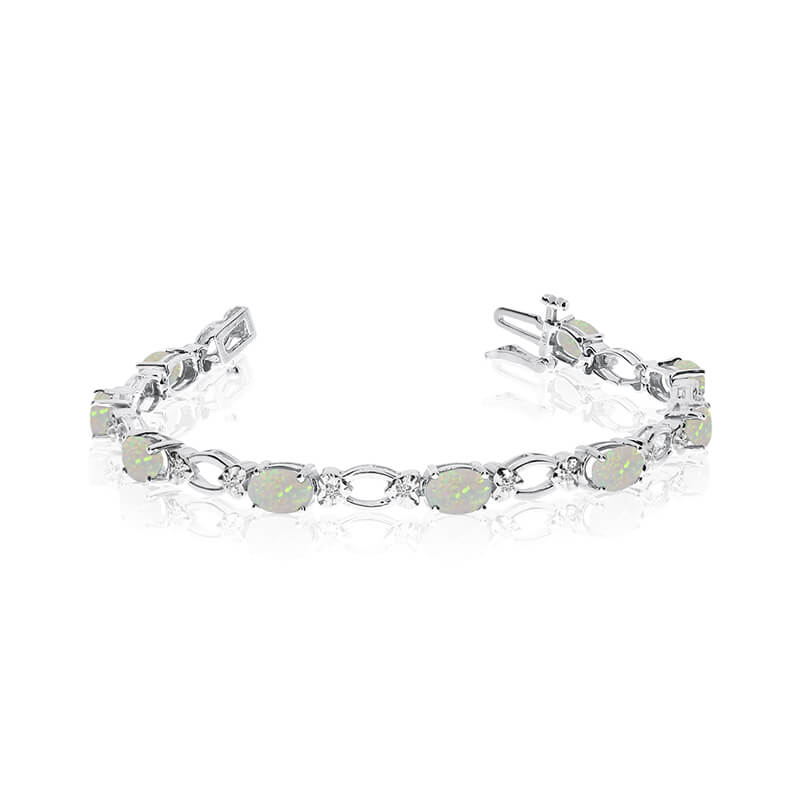 This 14k white gold natural opal and diamond tennis bracelet features 12 oval opals with a total ...
