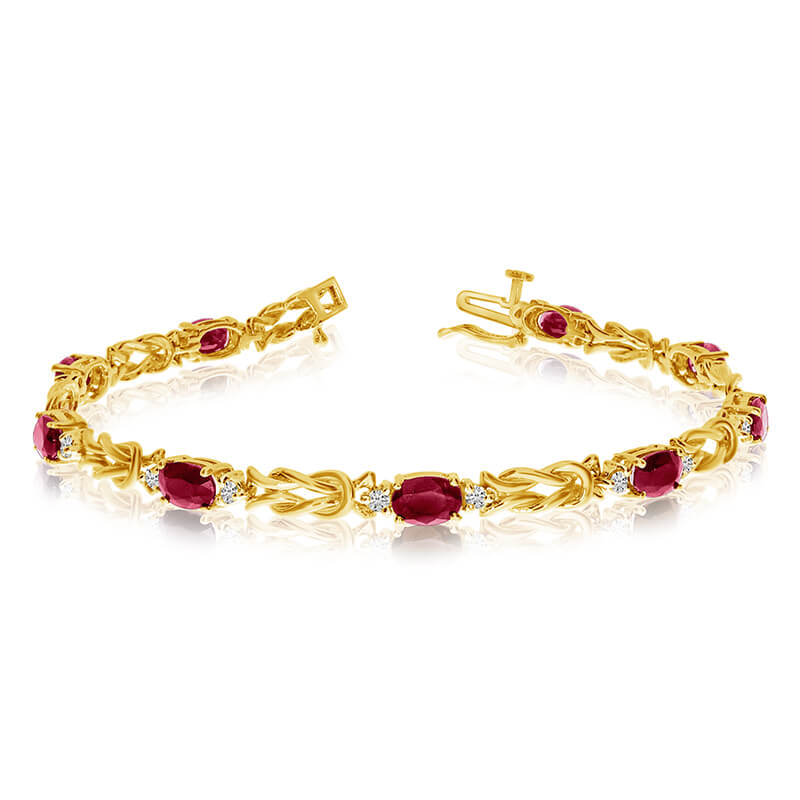 This 14k yellow gold natural garnet and diamond tennis bracelet features 9 oval garnets with a to...