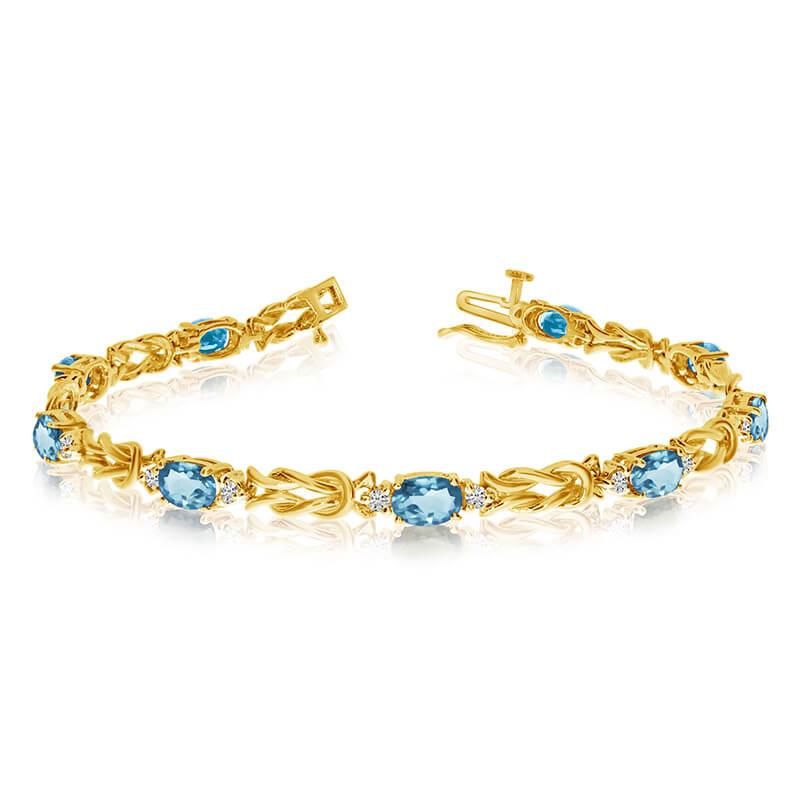 This 14k yellow gold natural aquamarine and diamond tennis bracelet features 9 oval aquamarines w...
