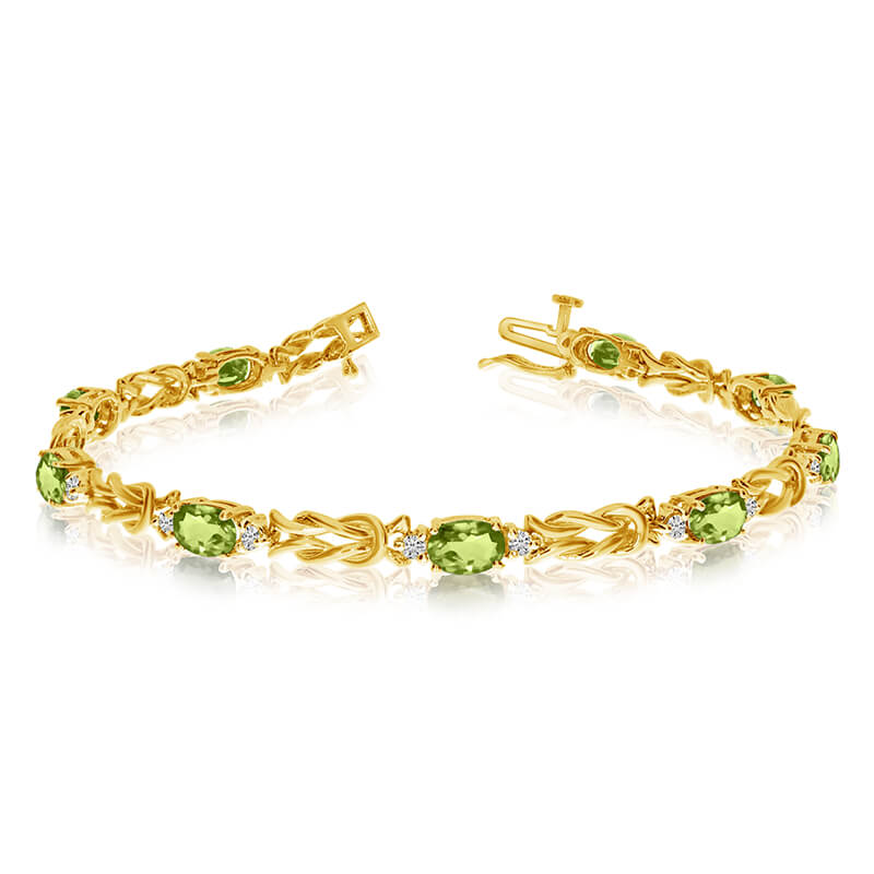 This 14k yellow gold natural peridot and diamond tennis bracelet features 9 oval peridots with a ...