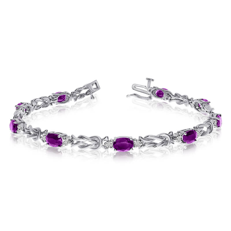 This 14k white gold natural amethyst and diamond tennis bracelet features 9 oval amethysts with a...
