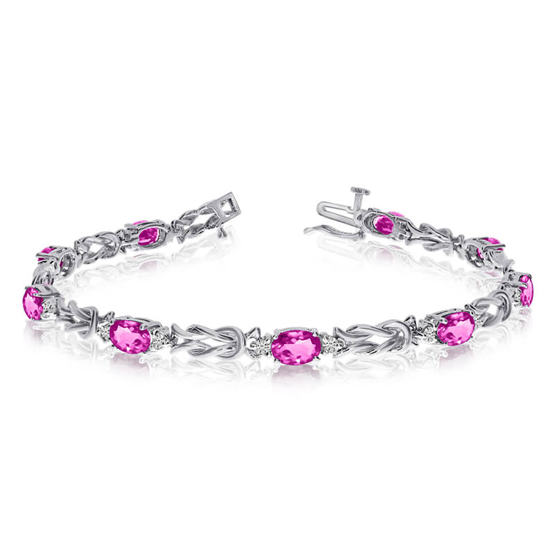 This 14k white gold natural mystic topaz and diamond tennis bracelet features 9 oval all natural ...