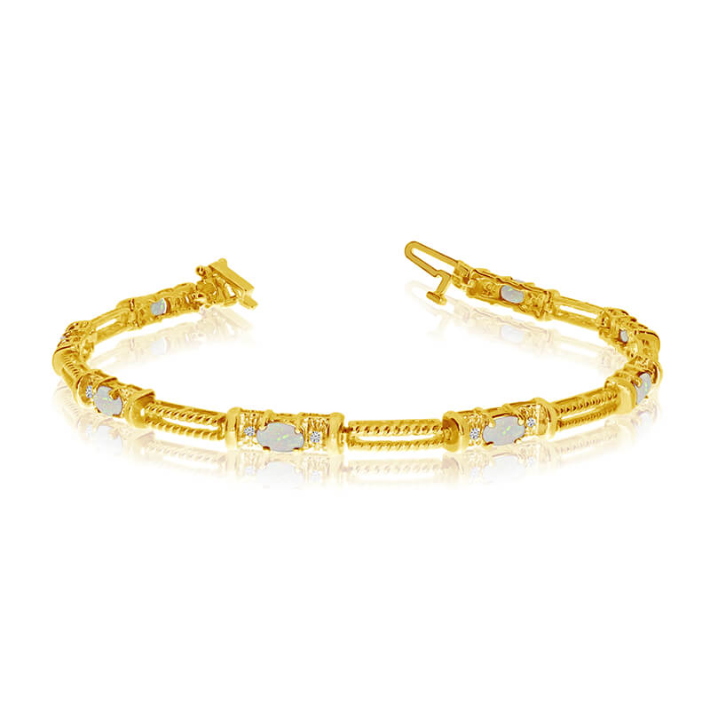 This 14k yellow gold natural opal and diamond tennis bracelet features 8 oval opals with a total ...