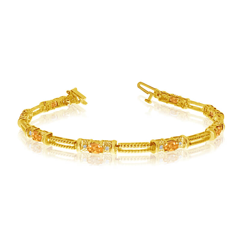 This 14k yellow gold natural citrine and diamond tennis bracelet features 8 oval citrines with a ...