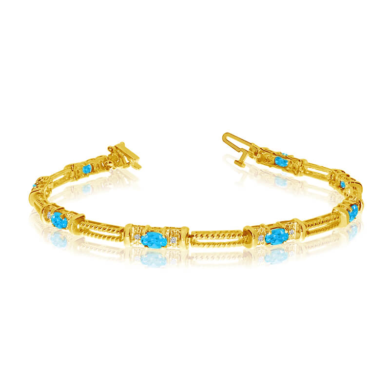This 14k yellow gold natural blue-topaz and diamond tennis bracelet features 8 oval blue-topazs with a total gem weight of 1.52 carats and a total diamond weight of 0.16 carats.