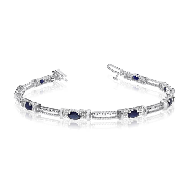 This 14k white gold natural sapphire and diamond tennis bracelet features 8 oval sapphires with a...