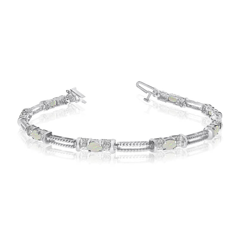 This 14k white gold natural opal and diamond tennis bracelet features 8 oval opals with a total g...