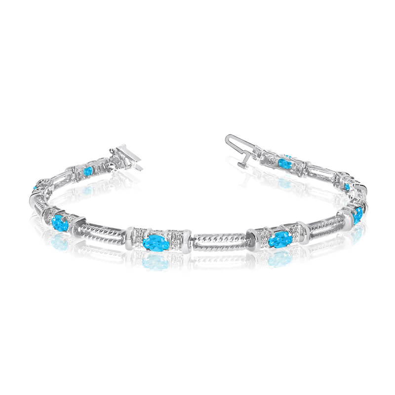 This 14k white gold natural blue-topaz and diamond tennis bracelet features 8 oval blue-topazs wi...