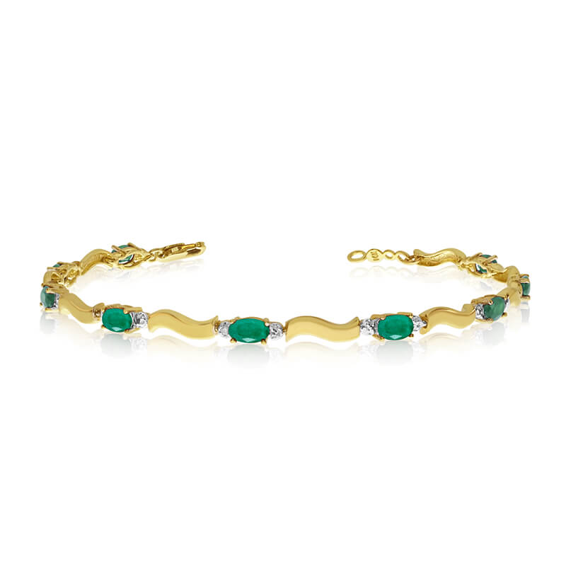 This 10K Yellow Gold oval emerald and diamond bracelet features nine 5x3 mm stunning natural emer...