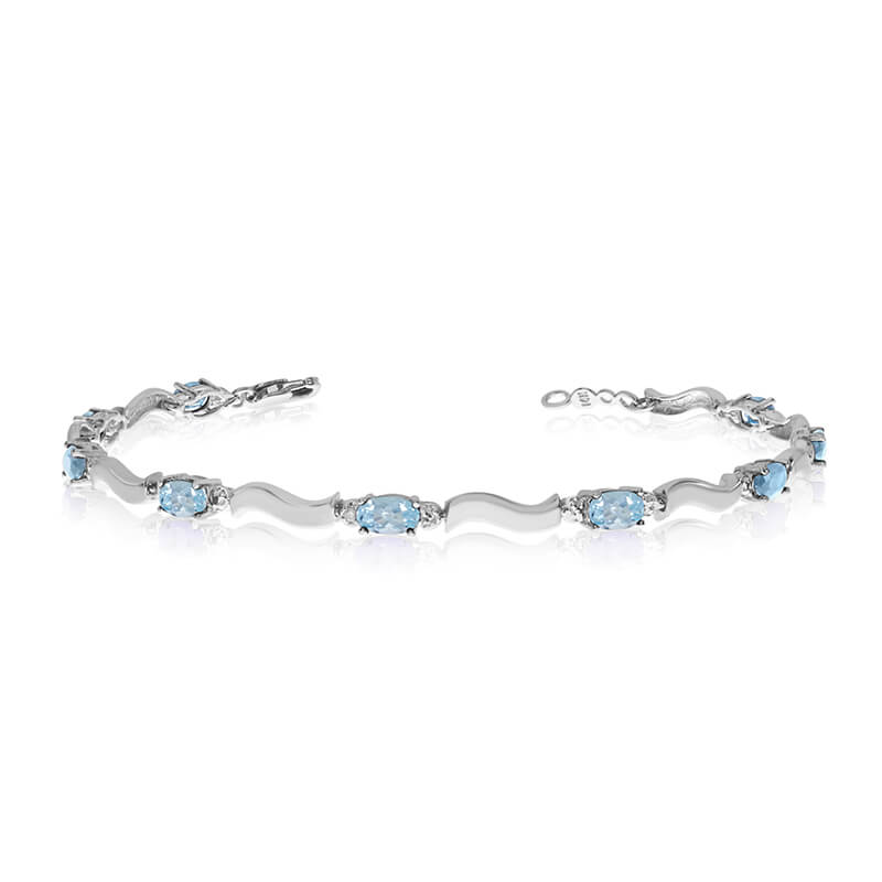 This 10K White Gold oval aquamarine and diamond bracelet features nine 5x3 mm stunning natural aq...