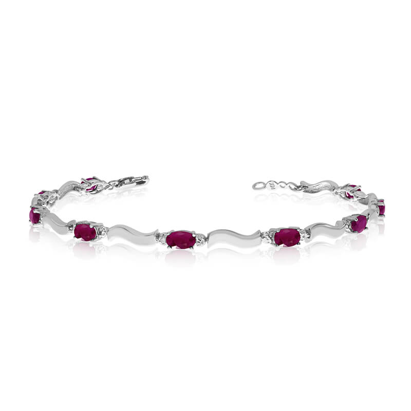 This 10K White Gold oval ruby and diamond bracelet features nine 5x3 mm stunning natural ruby sto...