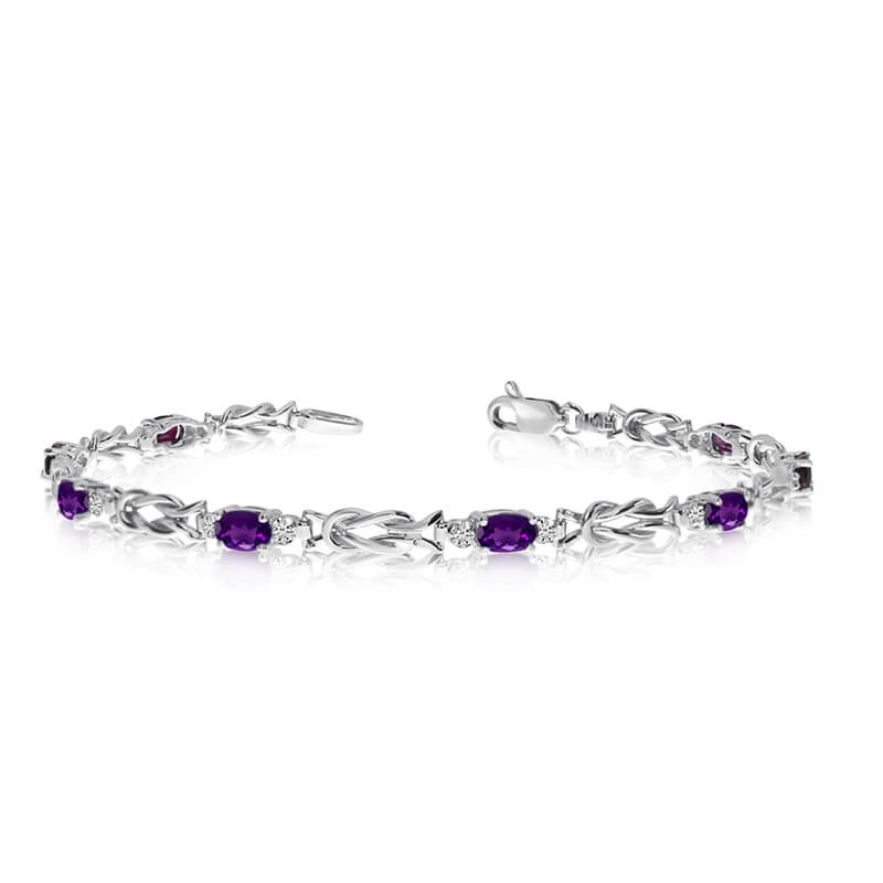 This 10K White Gold oval amethyst and diamond bracelet features eight 5x3 mm stunning natural ame...