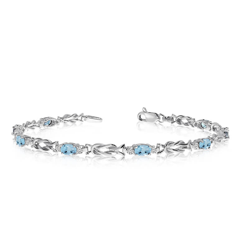 This 10K White Gold oval aquamarine and diamond bracelet features eight 5x3 mm stunning natural a...