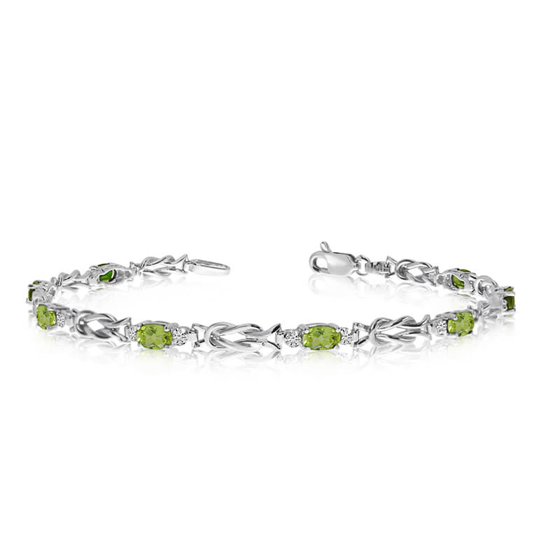 This 10K White Gold oval peridot and diamond bracelet features eight 5x3 mm stunning natural peri...