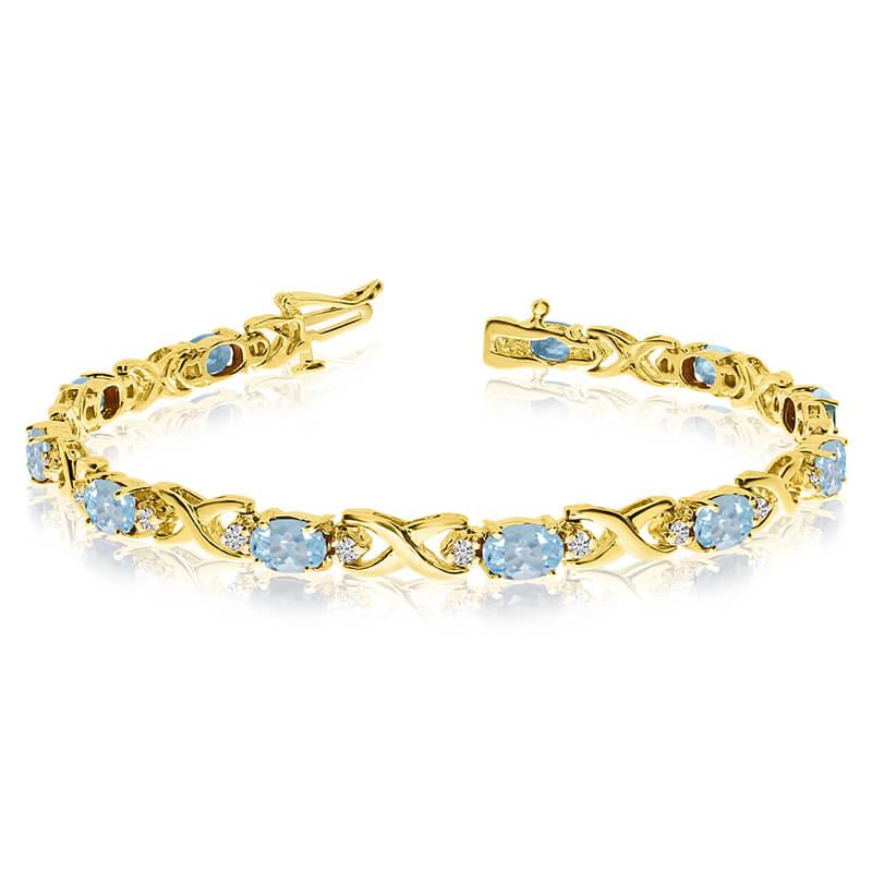 This 14k yellow gold natural aquamarine and diamond tennis bracelet features 11 oval aquamarines ...