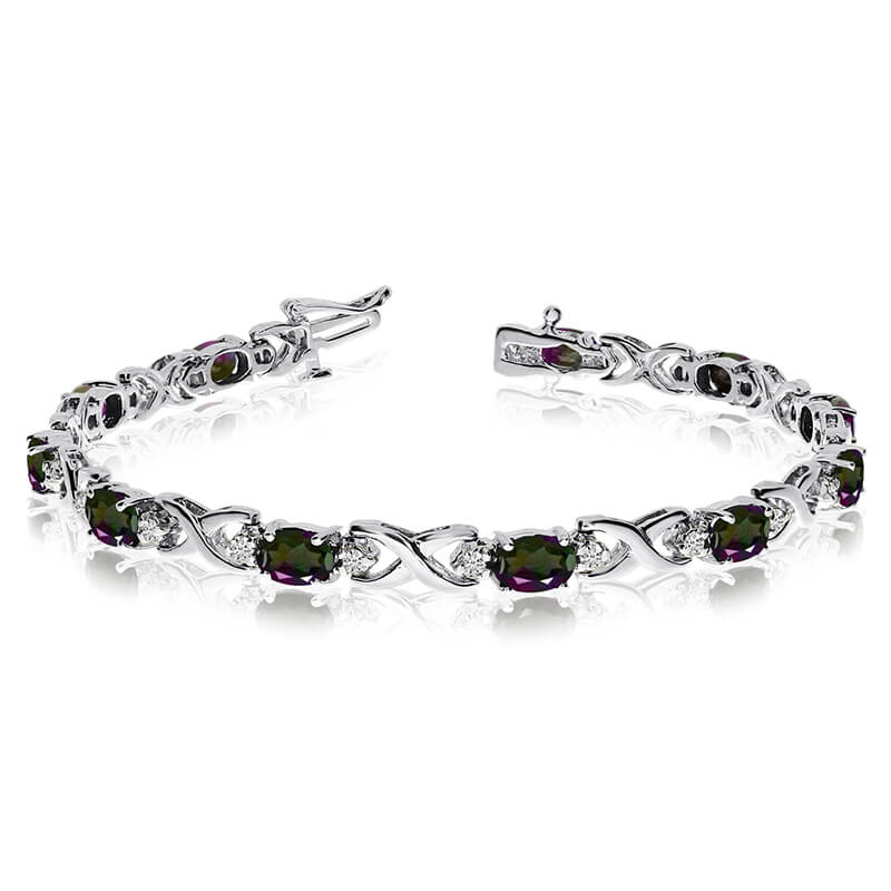 This 14k white gold natural mystic topaz and diamond tennis bracelet features 11 oval all natural...