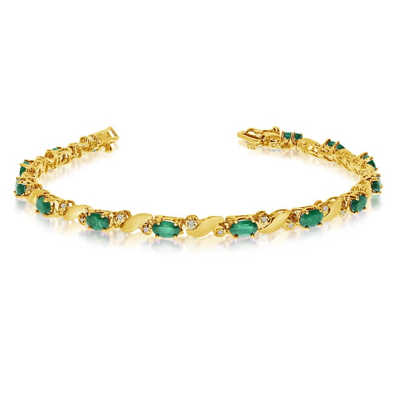 This 14k yellow gold natural emerald and diamond tennis bracelet features 13 oval emeralds with a...