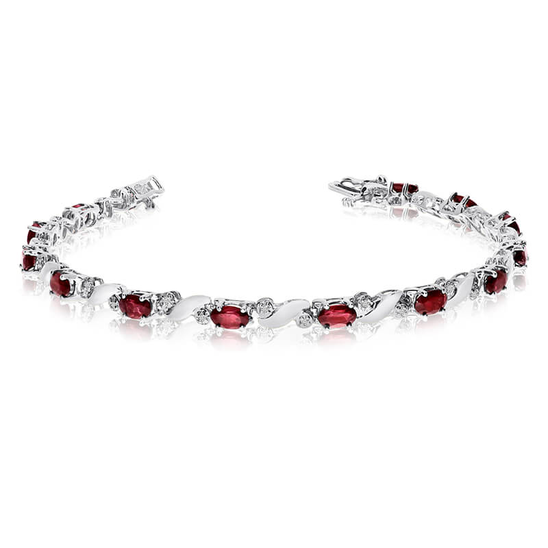 This 14k white gold natural garnet and diamond tennis bracelet features 13 oval garnets with a to...