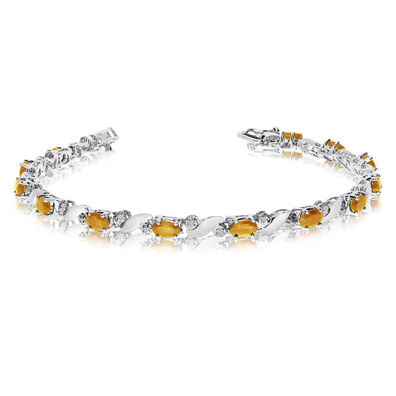 This 14k white gold natural citrine and diamond tennis bracelet features 13 oval citrines with a ...