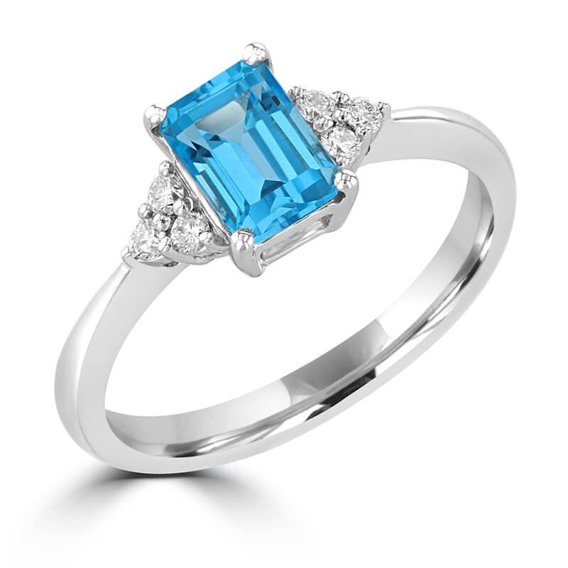 5X7 EMERALD CUT BLUE TOPAZ WITH THREE DIAMONDS ON EACH SIDE RING