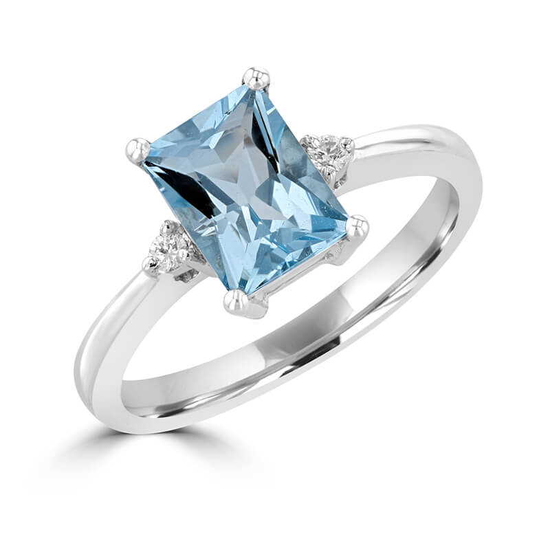 JCX391547: 6X8 FANCY BAGUETTE AQUAMARINE AND ONE DIAMOND EACH SIDE RING
