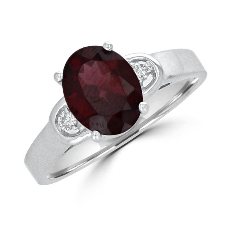7x9 OVAL GARNET AND DIAMOND ON EACH SIDE RING