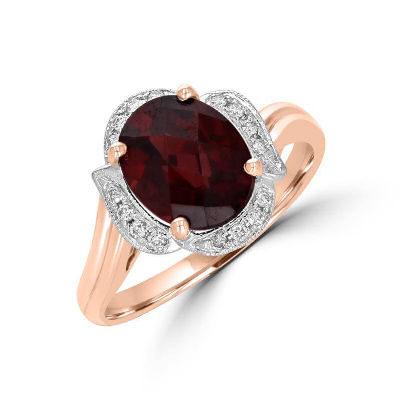 8X10 OVAL CHECKERED GARNET SURROUNDED BY LEAF SHAPE DIAMOND RING