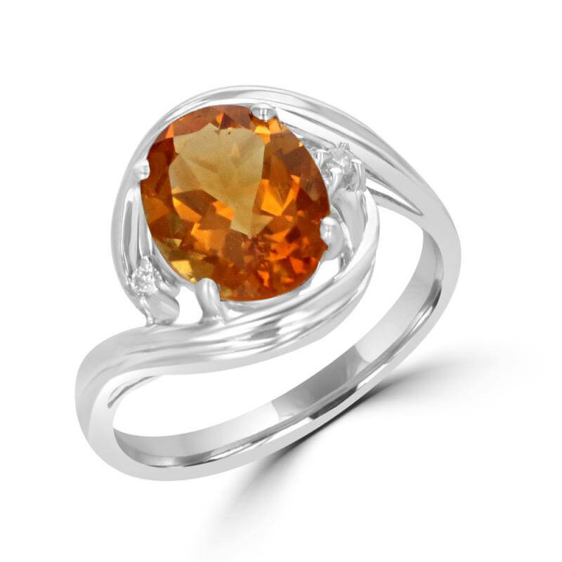 8X10 OVAL CITRINE AND ONE DIAMOND ON EACH SIDE RING