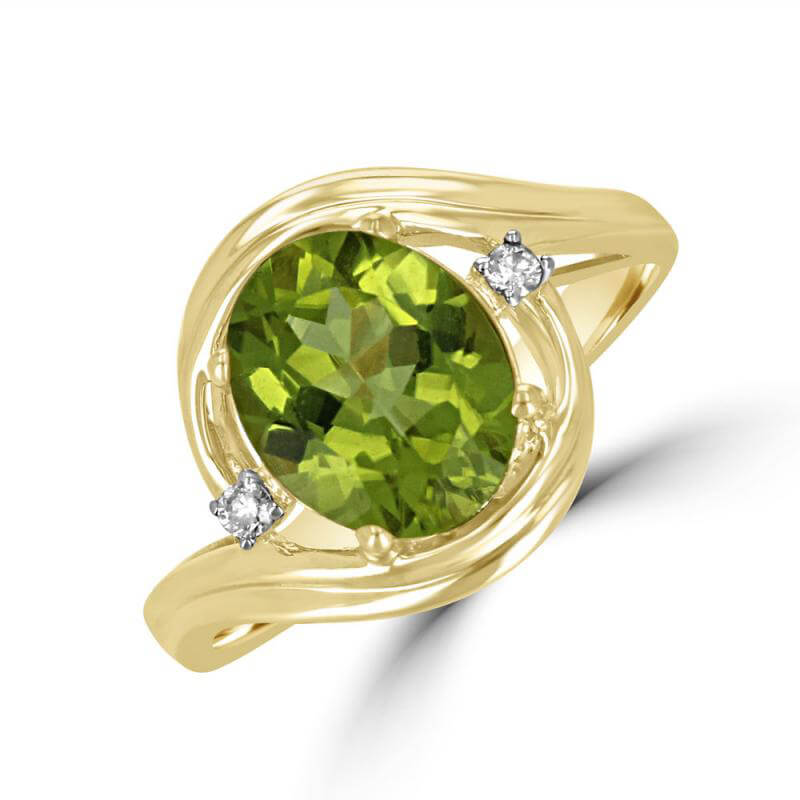 8X10 OVAL PERIDOT AND ONE DIAMOND ON EACH SIDE RING