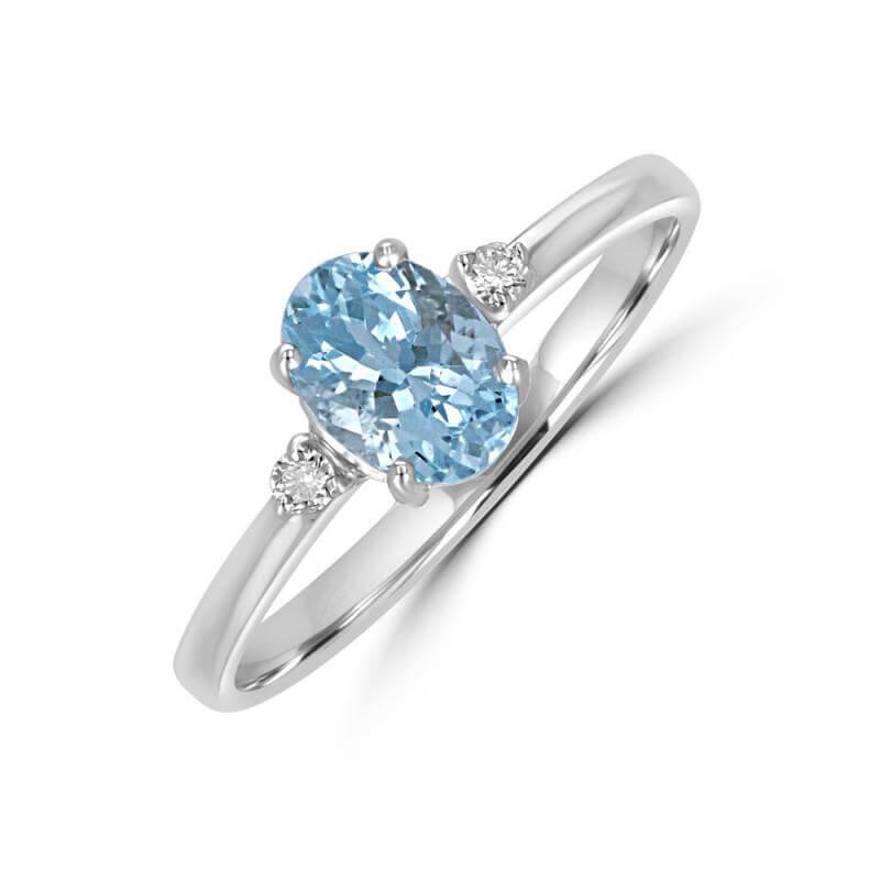 5X7 OVAL AQUAMARINE WITH DIAMOND ON EACH SIDE RING