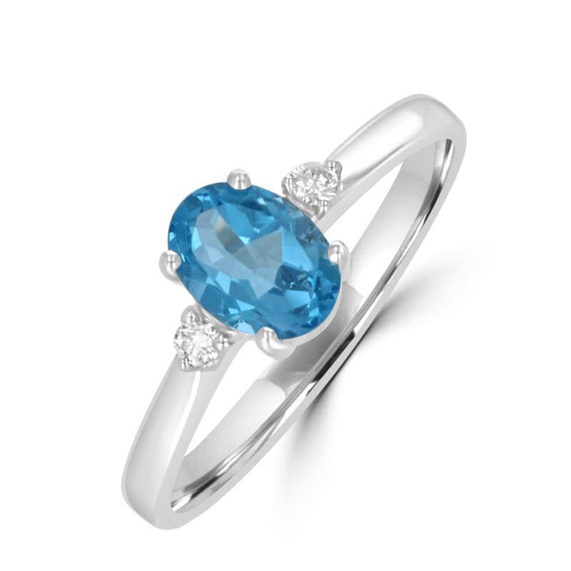 5X7 OVAL BLUE TOPAZ WITH DIAMOND ON EACH SIDE RING